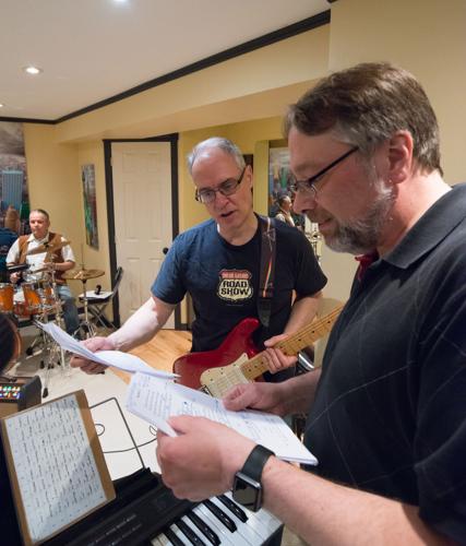 Rick Martin and Joe May look over some song notes at the Shades of Grey band practice in Kanata, Ontario, February 16, 2017. Photo by Garth Gullekson