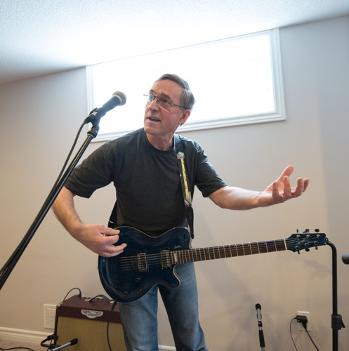 Marc playing air guitar at the Shades of Grey band practice in Barrhaven, Ontario, April 5, 2017. Photo by Garth Gullekson