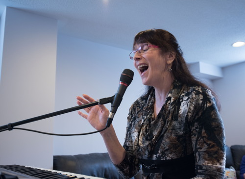 Kelly singing Heat Wave at the Shades of Grey band practice in Barrhaven, Ontario, April 5, 2017. Photo by Garth Gullekson